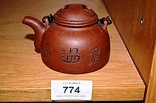 Chinese terracotta teapot with engraved detail