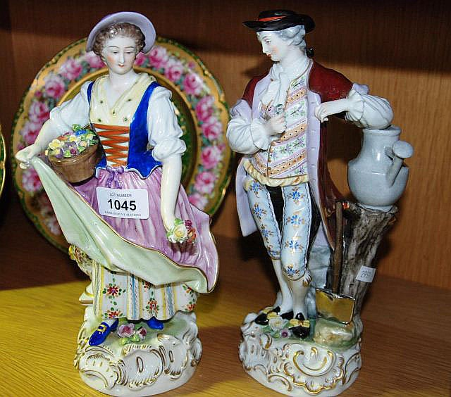 Pair of antique German porcelain figurines of a