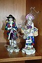 A pair of antique European porcelain figurines of