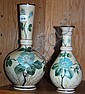 Pair of graduated hand-painted glass vases on a