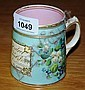 An antique hand painted name mug presented to