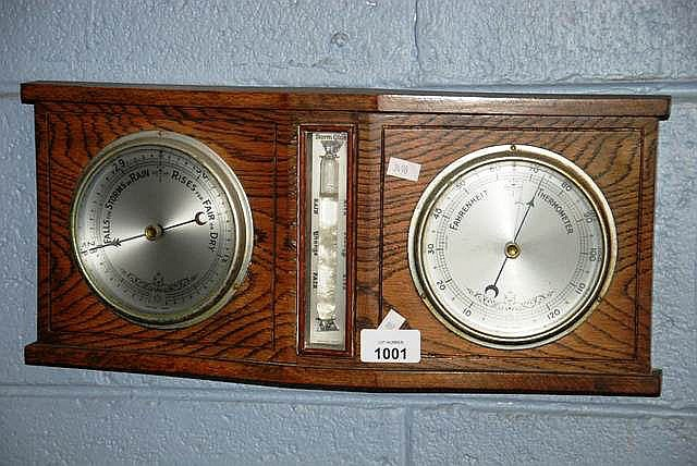 An oak cased weather station, with barometer etc.