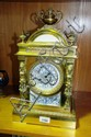 Antique French gilt brass mantel clock with a