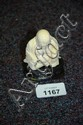 A small carved ivory figure of a sitting Buddha on