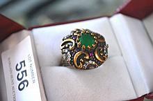 Ornate emerald, ruby, zircon ring set in brass