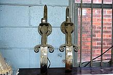 Pair of wall lights, each in the form of a bent