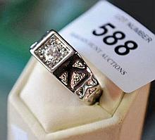 Ornate ring with cubic zirconia setting