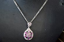 Ornate ruby pendant set on silver chain