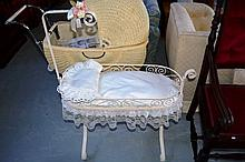 Cream painted wrought iron dolls rocking cradle,