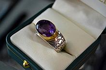 Ornate silver ring with amethyst setting