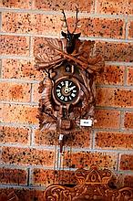 Vintage cuckoo clock, carved timber case with