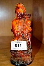 Chinese amber resin figure of a seated Buddha