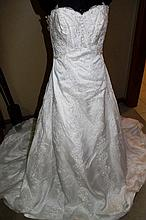 Wedding Dress. Brand new with tags,  Ivory beaded and sequined,