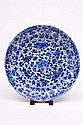 A Chinese blue and white dish: with shaped moulded