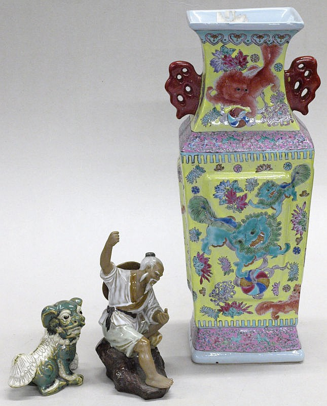 A late Chinese porcelain vase and two figures:,