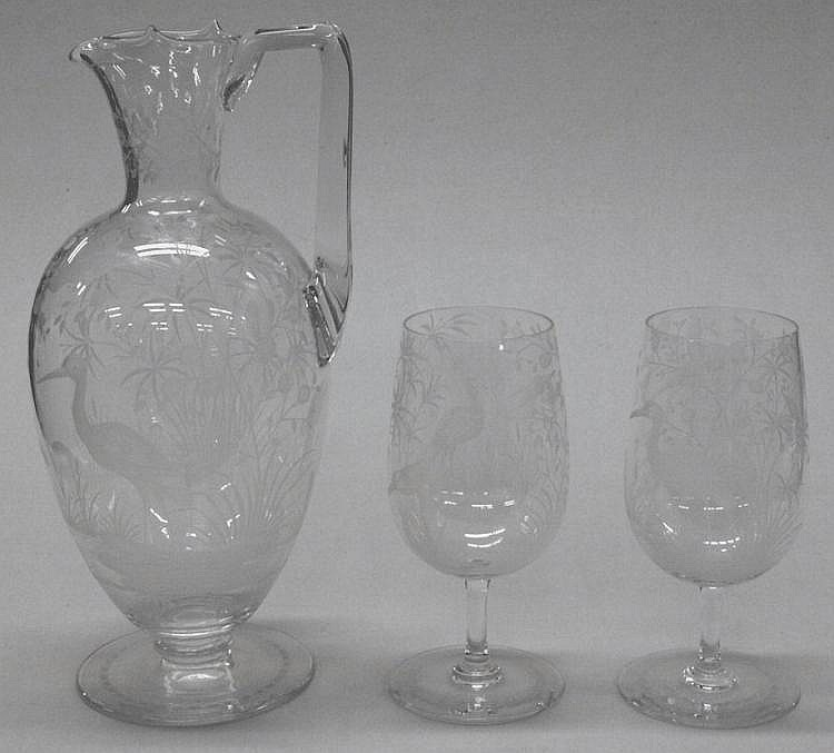 A late Victorian engraved glass jug: and two