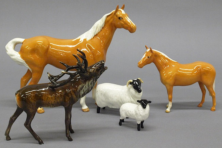 A Beswick Palomino and foal in gloss finish, a