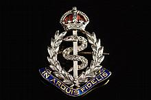 An enamelled and diamond mounted 'Royal Army Medical Corps' regimental brooch:, 33mm long.