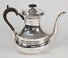 An Edward VII  silver coffee pot, maker John Heath & John Middleton, London, 1902: inscribed, of barge shaped outline with reeded girdle and domed hin