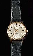 Eterna-Matic. A gentleman's 9ct gold wrist watch: the satin finish dial 29mm diameter,  with black & gold baton markers and hands, a sweep seconds han