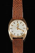 Zenith. A gentleman's 9ct gold wristwatch: the round silvered dial with raised baton numerals and hands, date aperture, sweep seconds hand and signed