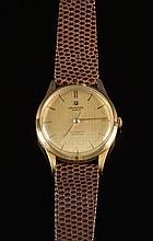 Universal Microtor. A gentleman's wristwatch:, the dial signed Universal, Geneve, Automatic, Microtor, with gold baton numerals and hands and sweep se