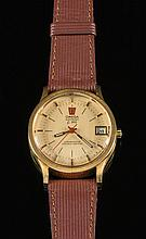 Omega f300. A gentleman's chronometer electronic wrist watch: the brushed dial having baton numerals & hands, a sweep seconds hand, date aperture and