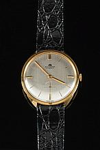 Bucherer. A gentleman's dress wrist watch: the round silvered dial having raised gold baton hour markings, baton hands, subsidiary seconds dial and si