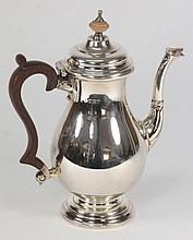 An Elizabeth II silver coffee pot, maker Adie Brothers Ltd, Birmingham, 1962: initialled, in the Georgian style, of plain baluster form with shallow d