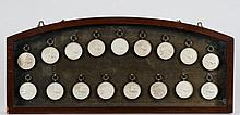 A cased set of seventeen Radcliffe Agricultural Society medals: dating from the 1840's / 1850's, contained in a mahogany and glazed display case of ar