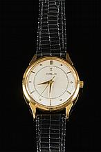 Gubelin. A gentleman's wrist watch: the round silvered dial having raised gold baton and diamond hour markings, dauphine hands and signed Gubelin, the