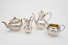 A Victorian matched four-piece tea and coffee service: of globular form with foliate, scroll and bird decoration, the teapot, maker WH, London, 1872,