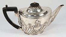 A Victorian silver oval teapot, maker Charles Stuart Harris, London 1897: of oval outline with scroll and foliate wrythen decoration, 16.11ozs.