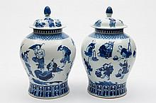 A pair of Chinese blue and white baluster vases and covers: each painted with fifteen figures including fruit and flower vendors and entertainers, apo