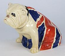 A Royal Doulton 'British Bulldog': his body draped with the Union Jack, pink printed factory mark, early 20th century, 15 cm high.
