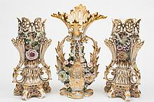 A pair of Jacob Petit porcelain vases and one similar: the former of lobed and pierced foliate form flanked by three similar smaller necks applied wit