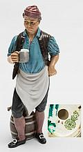 A Royal Doulton prototype figure: reputed to be titled 'Brewers Boy' modelled standing beside two barrels in buckled shoes, breeches, apron, shirt sle