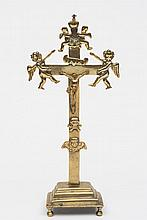 A  late 17th/ ealry 18th century  century Continental brass crucifix: possibly  Low Countries, the cross surmounted with angels, winged skull and skul
