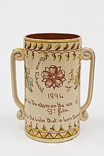 An Aller Vale (Torquay) pottery Royal commemorative loving cup: of cylindrical form, the handles with scroll terminals, incised 'Prince Edward of York