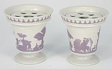 A pair of Wedgwood white smear glazed pot-pourri vases and inner covers: of small size, each applied with lavender reliefs of classical figures in a l