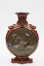 A Watcombe (Torquay) pottery moulded pilgrim flask: on cartouche shaped foot, with lion mask handles, the neck moulded with a band of stiff leaves, th