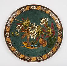 A large Watcombe (Torquay) pottery plaque: sgraffito decorated and colour filled with passion flowers and passion fruit and a kingfisher in flight, on