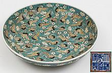 A Chinese 'Hundred Cranes' charger: decorated overall with cranes in flight on a prunus blossom green ground, apocryphal underglaze blue Qianlong seal