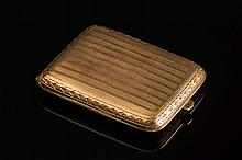 Tiffany & Co. A gold match box holder:, stamped