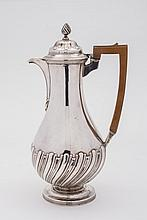 A Victorian silver hot water jug, maker's mark