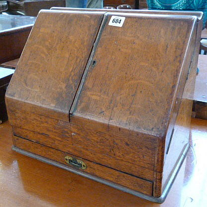 A Victorian oak slope front stationery box, 38cm