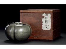 Persimmon shaped tin boxes of tea