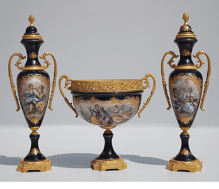 A three-piece garniture of Sevres-style vases