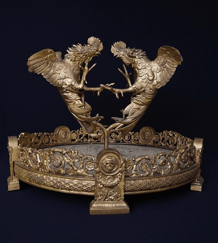 A French bronze sculpture depicting two gilded cocks fighting