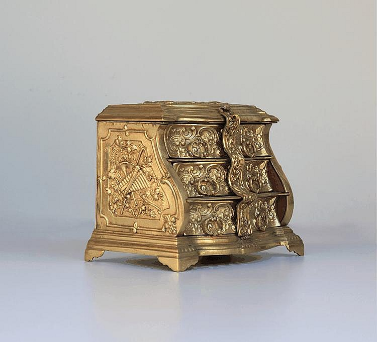 A decorative keepsake brass chest